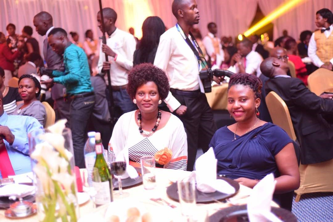 Ms.Sylvia Namubiru Mukasa,ED LASPNET (in white) and Ms. Jamidah Namuyanja,Networking & Partnership Officer LASNET during the dinner.
